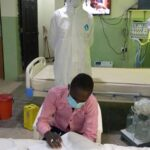 See Photo Of COVID-19 Patient Writing WAEC In Isolation Centre